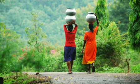 Tribal girls drinking water – Ranjan Panda