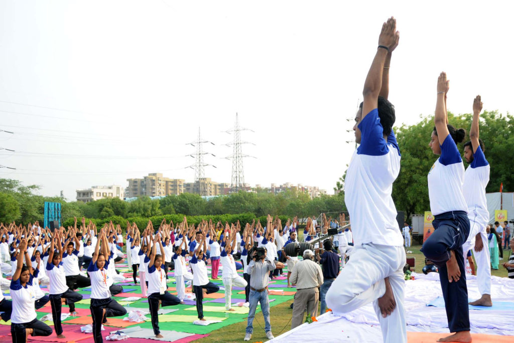 The participants in the mass performance of Common Yoga Protocol, organised by the Ministry of AYUSH and DDA with support of the Patanjali Yog Samiti, on the occasion of the 2nd International Day of Yoga – 2016, at Dwarka, in New Delhi on June 21, 2016.